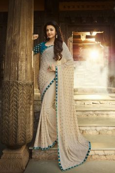Bollywood Diva Kajal Agarwal Cream Color Georgette Saree With Blouse And Embroidery