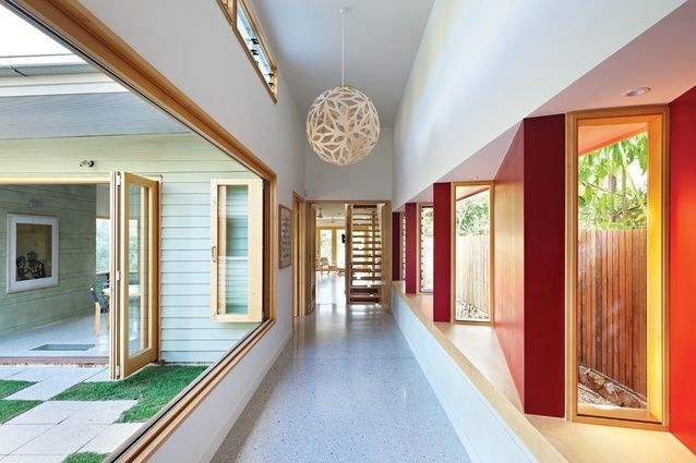 A widened hall opens onto a sunlit courtyard and acts as a circulation spine.