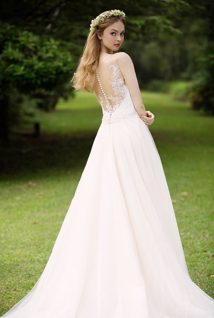 Champagne tulle skirt paired with a gorgeous illusion back, the ideal classic dress with a hint of colour. | Wedding Gown Singapore | Wedding Dress Singapore | Wedding Package Singapore | Wedding Gown Rental | Wedding Gown Purchase