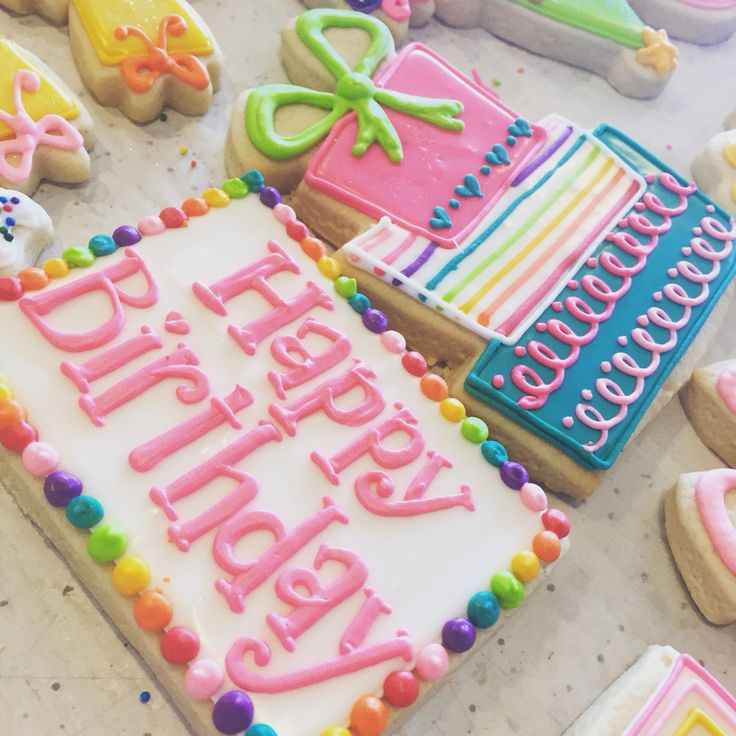 Bright rainbow birthday cookies by Hayleycakes and cookies