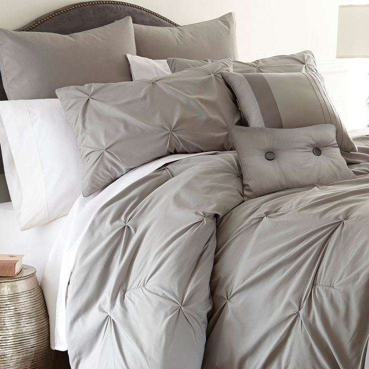 Sleep in luxurious comfort with this wonderful embellished comforter set. This set features year-round patterns and comes in multiple bright colors to fit into any home decor.