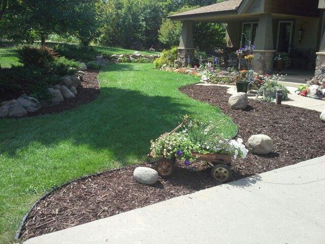 Brown mulch enhancing surrounding #landscape www.ringlawncare.com