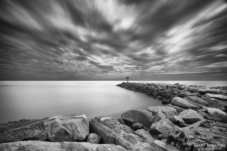 A stormy day at the Oceanside Harbor Jetty. I used a long exposure time and 13 stops of 2 stacked ND filters.