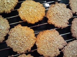 Gluten-Free Sesame Crackers  Makes 32 crackers  1 cup of almond meal/flour 1 cup of flaxseed meal 1/2 cup of brown rice flour 5 Tbsp of egg whites 3 Tbsp of olive oil 3 Tbsp of sesame seeds 1 Tbsp of water 1 tsp of garlic powder 1 tsp of onion salt coarse salt – enough to sprinkle over crackers