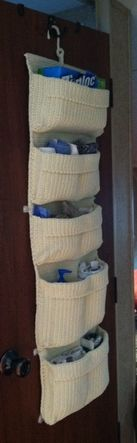 attach a hanging pocket storage from Ikea on the outside of the bathroom door for hand towels, washcloths, plastic bags, etc.