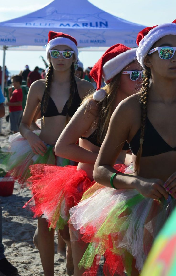 Surfing Santas Cocoa Beach Draws Record Crowd and Over 800 Santas Riding the Waves