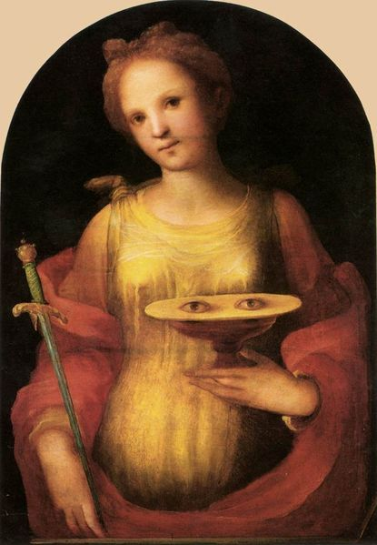 "Santa Lucia by Domenico Beccafumi 1521 - Siena  The emblem of the eyes on the cup, or plate, must be linked to popular devotion to her, as protector of sight, because of her name, Lucia (from the latin word ""lux"" which means ""light"")"