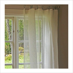 White and crisp, linen curtains.