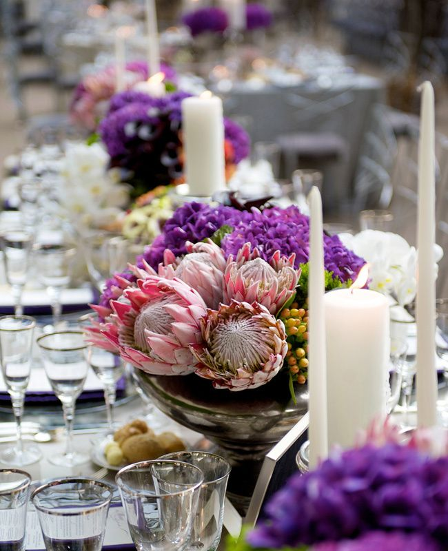 Purple floral centerpiece with giant king proteas | Modern Day Floral | Jen Kroll Photography