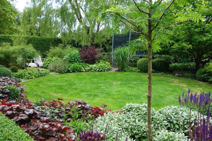 circle lawn with mixed perennial border