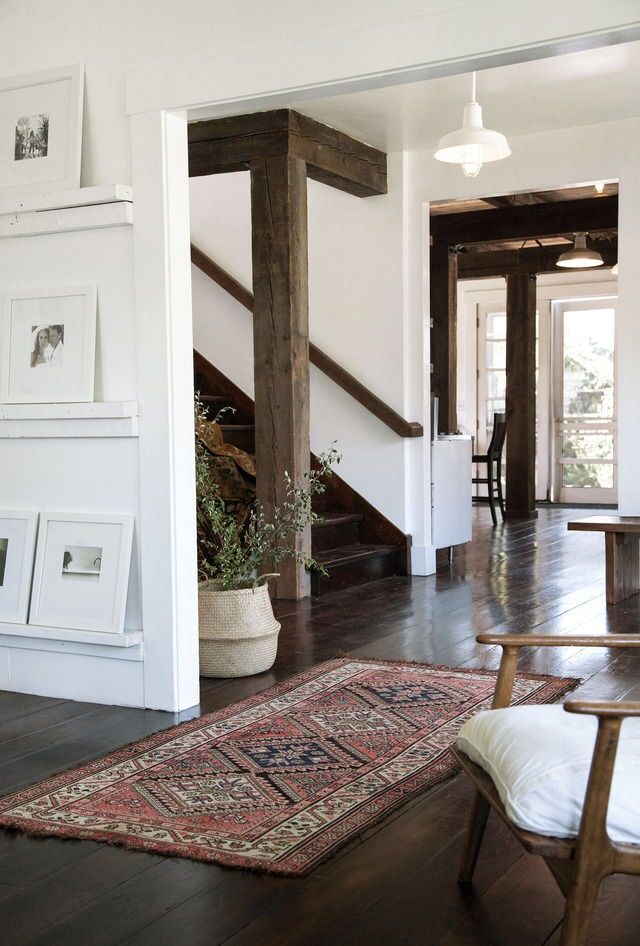 Rustic simplicity . So beautiful . Living room stairway hallway design