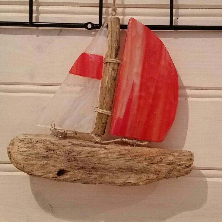 Sailboat of old wood and glass sails