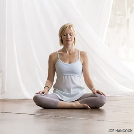 Don't let the name fool you. If you're used to sitting in chairs, Easy Pose or Sukhasana can be quite challenging.