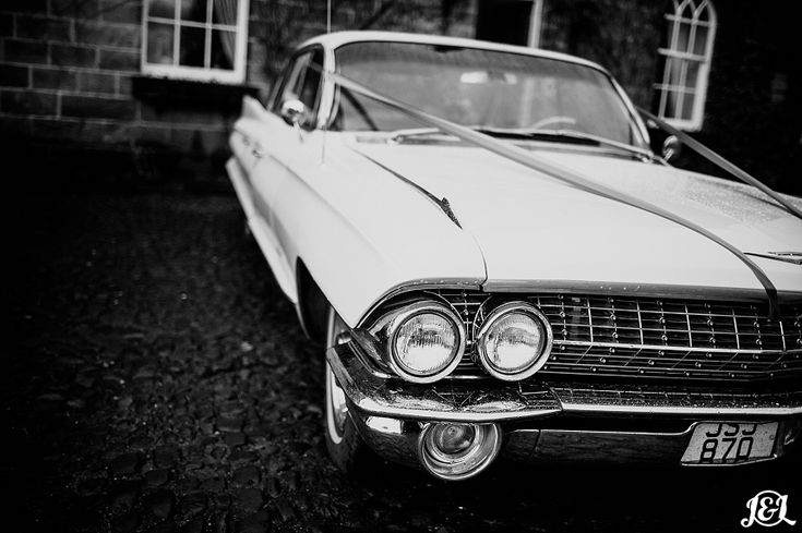 Very Cool Vintage wedding car  The bride wore a Vivienne Westwood wedding dress. The groom wore Jimmy Choo shoes.  Uber-stylish it was oozing with winter-wedding chic! Held in the opulence of Ripley Castle just outside of Harrogate,  banquet style wedding breakfast before having one of the best DJ set-lists ever to party out the Christmas/New Year party season wedding in style!   Want to See more?   Visit www.jamesandlianne.com  Yorkshire Based Wedding Photographers