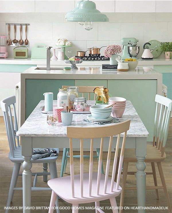 A Gorgeous Pastel Dining Room and Kitchen Area with painted chairs