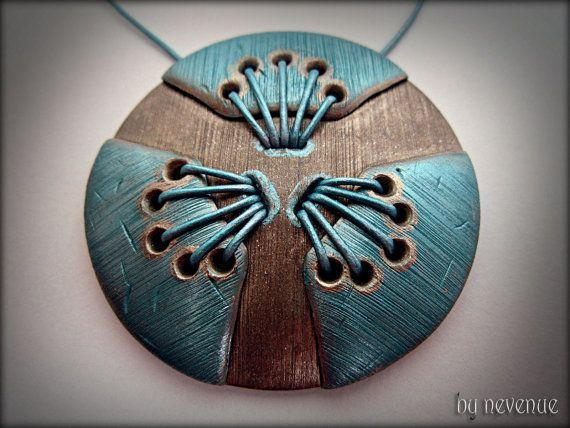 Sky Crevice - Polymer Clay pendant in shades of turquoise and antique silver, stitched with metallic turquoise leather cord. on Etsy, $39.36