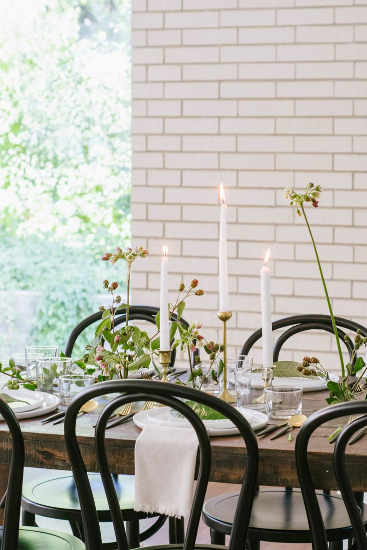 Bohemian Chic Wedding Tablescape | Black and Gold Bistro Chairs and Rustic Farm Tables | Modern Black and Gold Flatware, Neutral Fringed Napkins and Organic Dinner and Salad Plates | Leaf Calligraphy Place Cards | Brass Candlesticks and Wild Florals | via Birch & Brass Vintage Rentals for Weddings and Special Events in Austin, TX