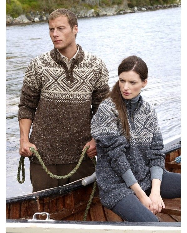 """This Irish sweater comes knit in 100% Donegal wool from the North West Coast of Ireland. This particular wool has fleck throughout which gives it its very own Donegal tweed look. The """"V"""" neck jumper has a high half zip collar.The key feature of the sweater is the Fairisle pattern. As it is made from 100% Irish wool it has that extra warmth, a real Irish jumper. The yarn used is spun in the famous Donegal Yarns Spinning Mill in Kilcarra, County Donegal."""