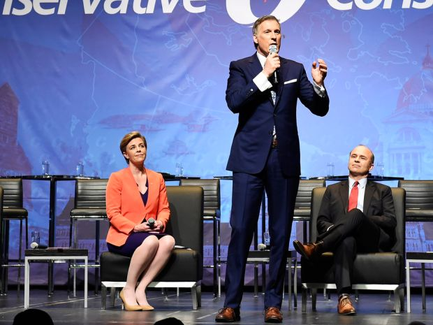 Candidate Maxime Bernier speaks as Kellie Leitch and Rick Peterson listen during the Conservative leadership debate in Toronto on Wednesday April 26, 2017.