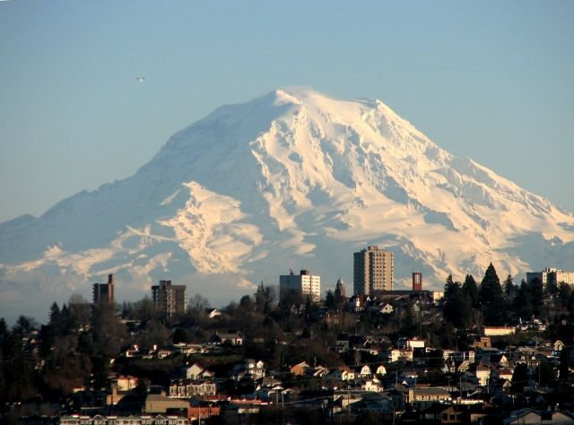 Mount Rainier. It towers over the city so beautifully. I especially love the view in the morning, with the sunset as the background.