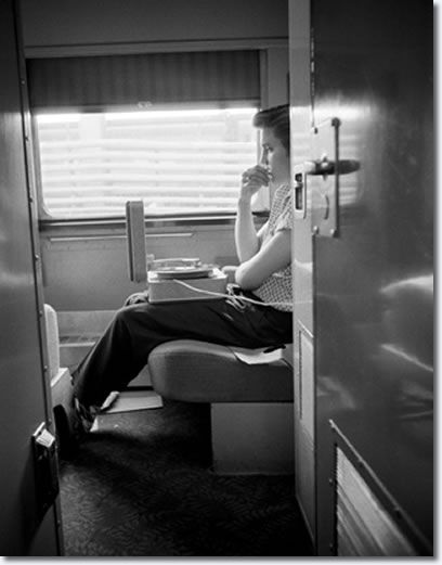 1956. Elvis on the 27 hour train ride from NYC to Memphis.  In a few months he would be the most talked about entertainer in the world, when photographer  Alfred Wertheimer took these photos he was still unknown.