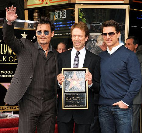 Johnny Depp showed off a shorter hairdo at the star ceremony for producer Jerry Bruckheimer, alongside fellow 80s heartthrob Tom Cruise, on Monday, June 24.