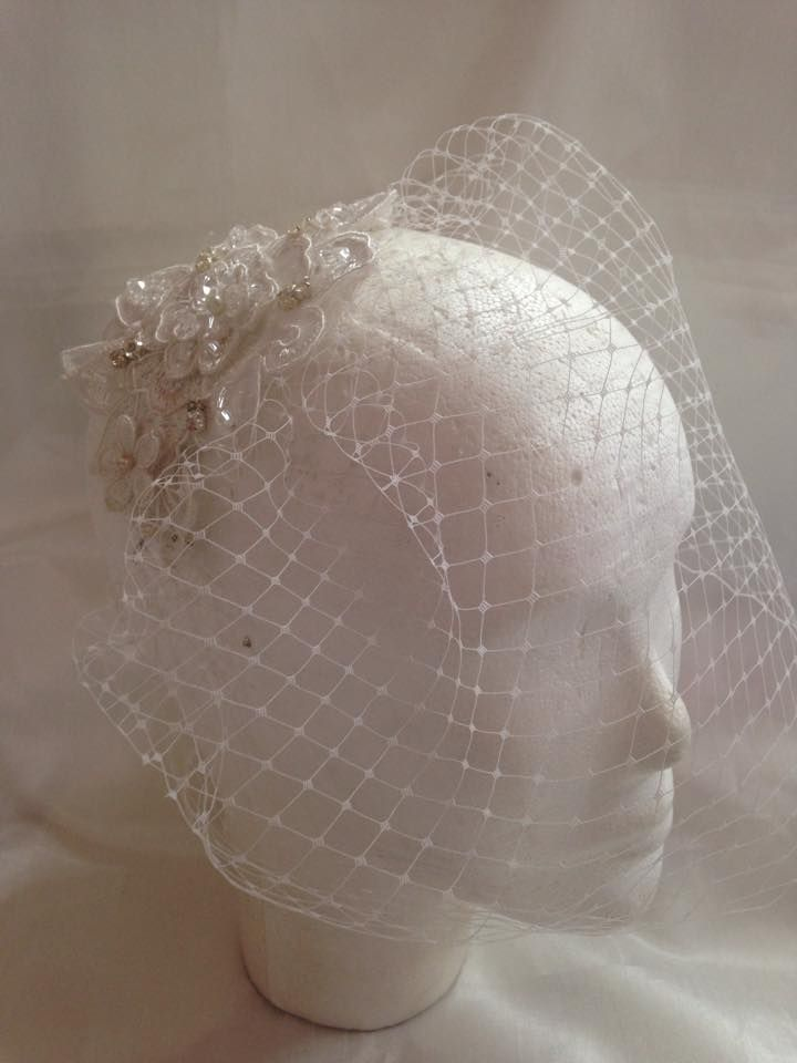 Birdcage veil with beaded lace comb.