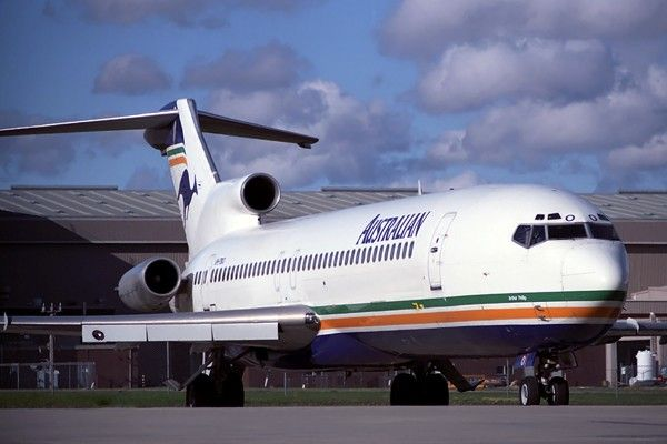 """Australian Airlines Boeing 727-276/Adv VH-TBO """"Arthur Phillip"""" having it's flight control surfaces tested while taxiing out for a take-off, circa 1990."""