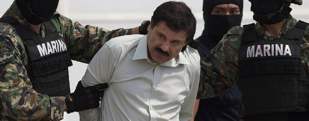 """Joaquin """"El Chapo"""" Guzman is escorted to a helicopter in handcuffs by Mexican Navy Marines. (AP)"""