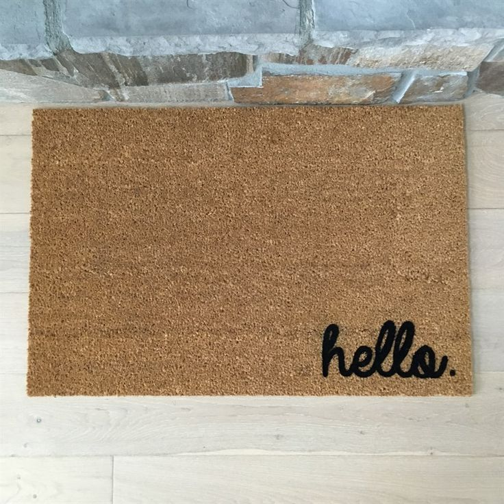 "Our high quality door mat is rugged and heavy-duty. It features our ""hello"" text created with embedded nylon for long lasting durability."