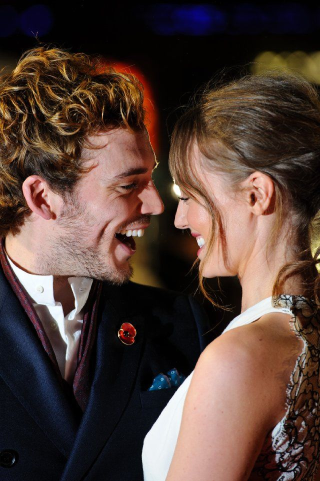 Laura Haddock and Sam Claflin at event of The Hunger Games: Catching Fire
