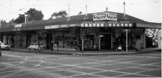 Four Ways Milk Bar, in a block of shops, cnr Glenferrie Road & High Street, 1950. Photo taken by Peter Wille.