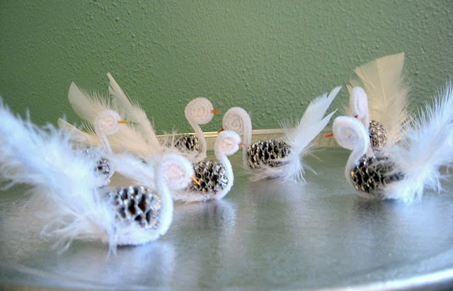 Seven Swans a swimming - pipe cleaners, pine cones, feathers and hot glue gun - O.o and toothpick for beak