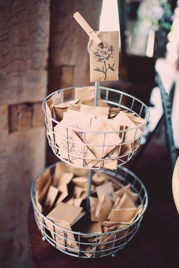seed packet favors // photo by Joyeuse Photography http://ruffledblog.com/bohemian-barn-wedding #favors #weddingfavors #seedpackets