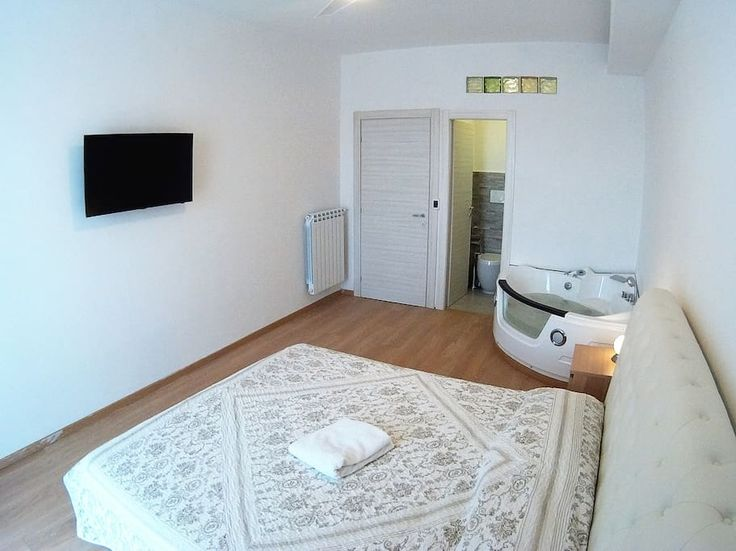 1st Bedroom with Jacuzzi, private bathroom, little balcony, air con, tv, led lights games, fan, safebox!