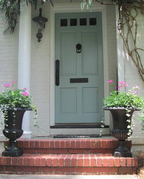 Love this front door. The door color is Benjamin Moore Wythe Blue; door handle set is by Weslock; exterior paint color is unknown but is close to Benjamin Moore China White or Pratt and Lambert Gray Moire.