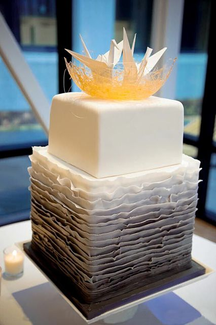 The Most Insane Wedding Cakes We've Ever Seen #refinery29  http://www.refinery29.com/wedding-cakes#slide6  Origami cranes perch on a nest of spun sugar in this modern, haute couture marvel from Chicago-based Amy Beck Cake Design. The top tier, a cube of simple white fondant, provides a bright juxtaposition to the bottom's imperfect, ombré gray ruffles.