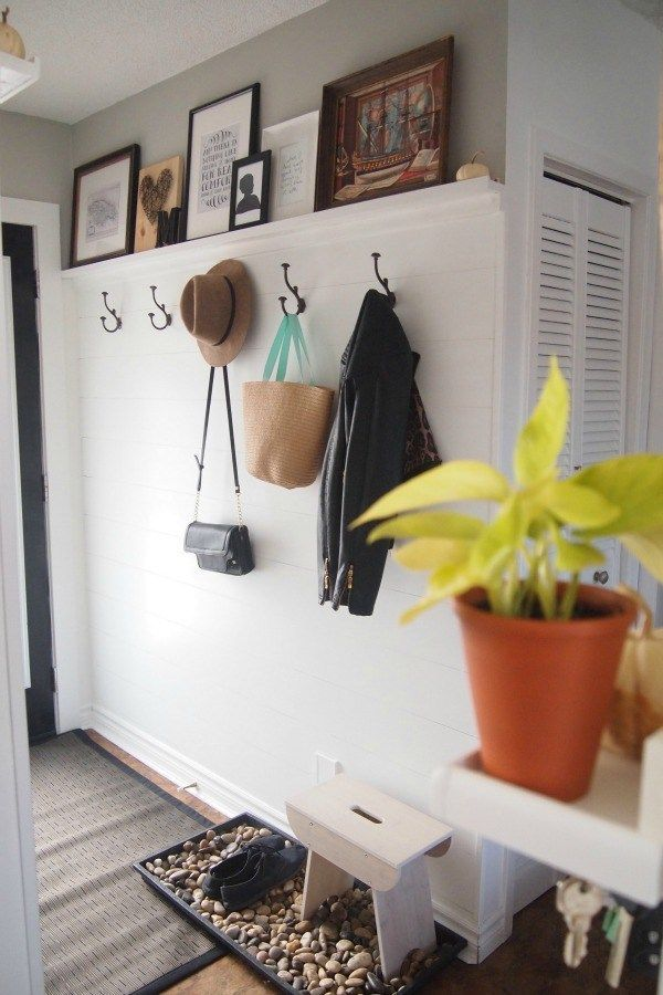 Entryway makeover with faux shiplap and a DIY picture ledge #shiplap #diyshiplap #entryway #mudroom