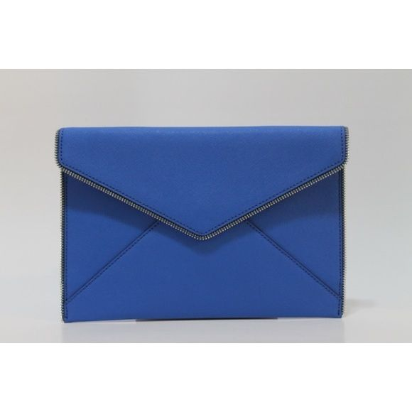 Rebecca Minkoff Leo Envelope Grecian Clutch Rebecca Minkoff Leo Envelope Grecian Clutch 100% Authentic   Color: Blue Style: HH15ESSC17 Retail: $95.00  Open zip teeth trace the edges of a slim envelope-flap clutch crafted from scratch-resistant Saffiano leather. Magnetic-snap flap closure. Six interior card pockets. Print lining. Leather/PVC/polyester. By Rebecca Minkoff; imported. Rebecca Minkoff Bags Clutches & Wristlets