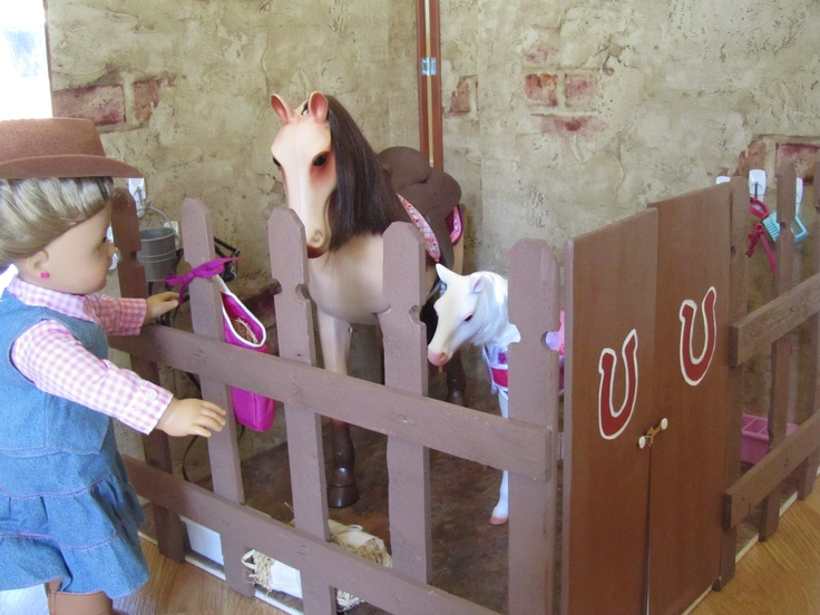 Pinner says: Build your own stable for the American Girl Doll horses: Two pieces of wood 2' x 2' put together with hinges.  Decorate the wood with wall paper, add a floor with 4 1' tiles.  Make a fence with garden edging and paint to finish off.  We added two hinged doors to get the horses in and out.  My daughter plays with this everyday! Enjoy!