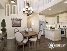 The open-to-above dining space is adjacent to the kitchen. White u-shaped Kitchen with central island, pass through to Great Room, decorative chimney hood fan. The Amethyst floorplan, by Kimberley Homes, Edmonton #kitchen #kitchenideas #kitcheninspo #kitchenreno #whitekitchen #interiordesign #newhomedesign #homedesign #newhome #customhome #yegre #buildwithkimberley #kimberleyhomes