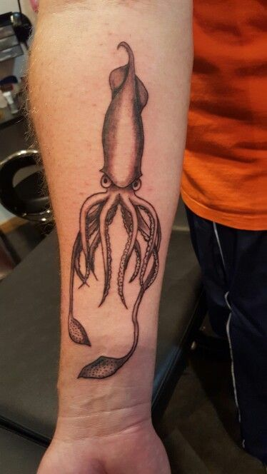Squid tattoo on forearm