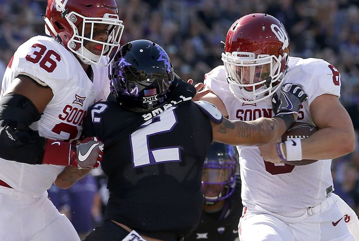 Oklahoma's Baker Mayfield (6) pushes TCU's Niko Small (2) as he scores a touchdown beside Oklahoma's Dimitri Flowers (36)  during a college football game between the University of Oklahoma Sooners (OU) and theTCU Horned Frogs at Amon G. Carter Stadium in Fort Worth, Texas, Saturday, Oct. 1, 2016. Photo by Bryan Terry, The Oklahoman