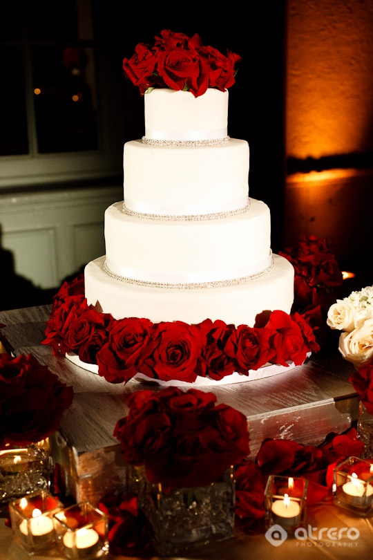 Whoa, baby!  Talk about GLAM!  While the cake itself is relatively simplistic, the deep red roses and crystals used as piping make this cake a total knock-out.  Would be best for an evening wedding, a black-tie wedding and/or a winter wedding.