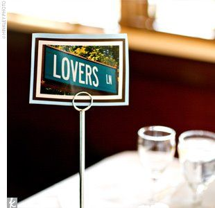 Love the idea of using street signs instead of table numbers at a wedding reception