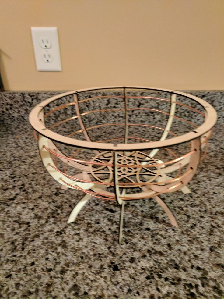 Laser cut wooden bowl with copper wire accents.