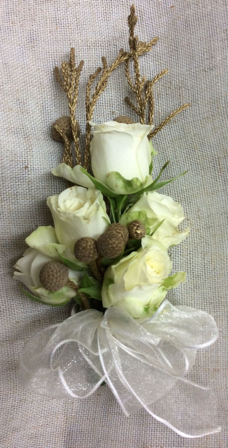 Ivory and gold corsage by Cathey's flowers