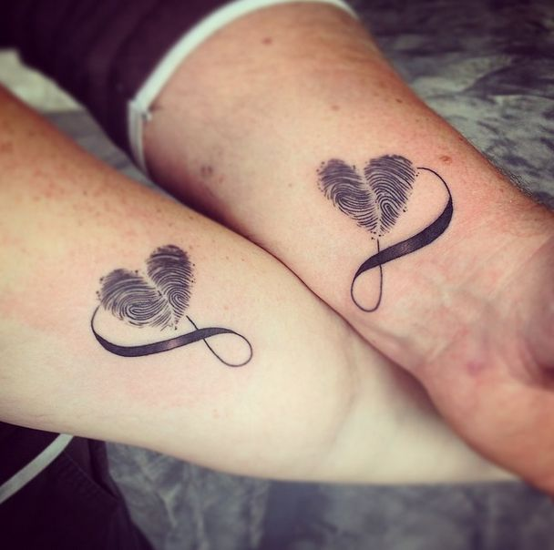No one in the world has these tattoos that tattoo artist Bella created besides these two love birds. They used their own thumbprints to form a...