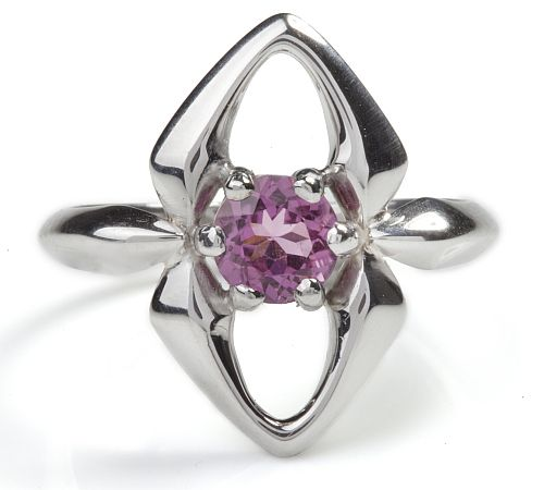 An elegant ring which boasts a white rhodium plated surface that contrasts with a dazzling faceted pink tourmaline