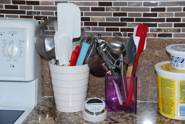 Just used old flower pots to put spatulas and other kitchen utensils!
